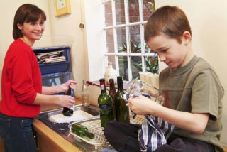 mother and son selecting bottles for recycling